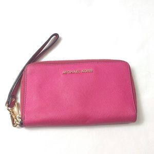 Michael Kors hot pink wallet with wristlet band